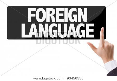 Businessman pressing button with the text: Foreign Language