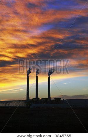 3 Smoke Stacks at Sunrise