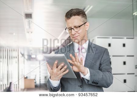 Young businesswoman using copy machine in office