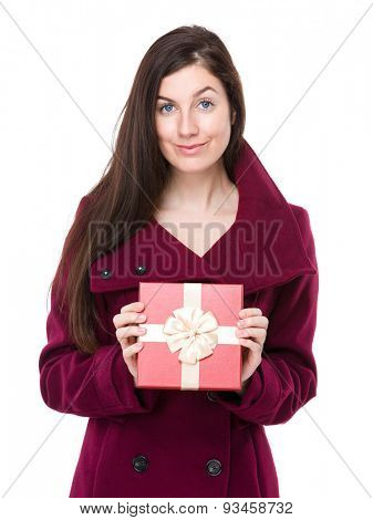 Young woman holding with gift box