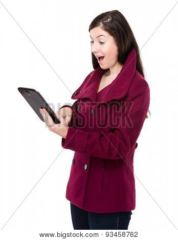 Brunette woman excite on reading tablet pc