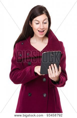 Young woman excite with using digital tablet