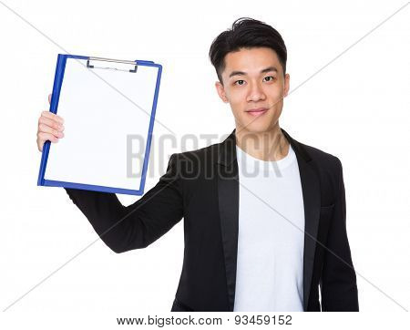 Young businessman show with clipboard and white paper