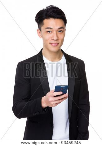 Young businessman use of mobile phone