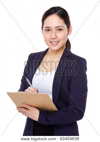 Asian businesswoman write on clipboard
