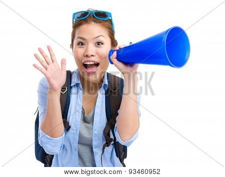 Young woman thrilled to use the megaphone for yelling