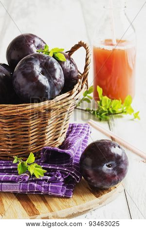 Ripe Plums And Plum Juice