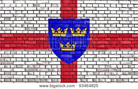 Flag Of East Anglia Painted On Brick Wall