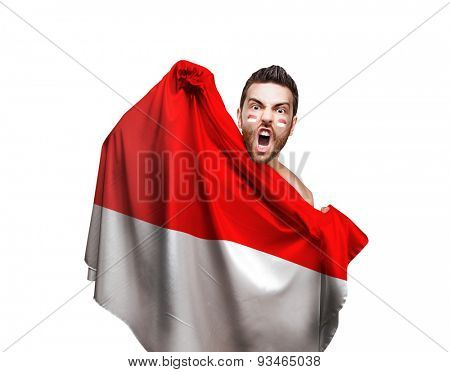 Fan holding the flag of Indonesia on white background