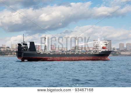Ship of dry cargo on a background Vladivostok. Eastern Bosphorus Strait, Russia.