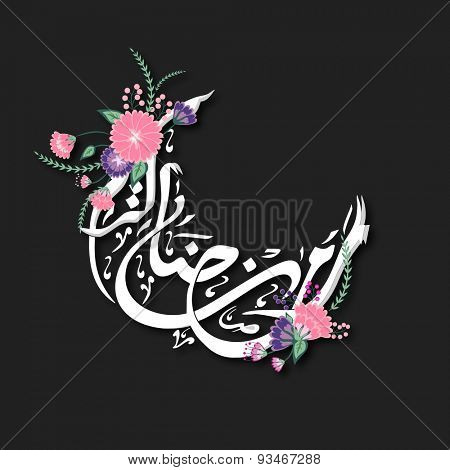 Arabic calligraphy of text Ramadan Kareem in flowers decorated crescent moon shape for Islamic holy month of prayers, celebration.