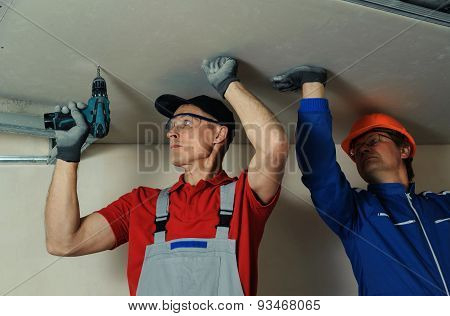 Workers Fixes The Drywall
