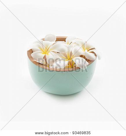 wooden bowl of white frangipani