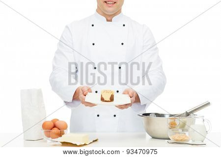 cooking, profession, haute cuisine, food and people concept - close up of happy male chef cook baking dessert