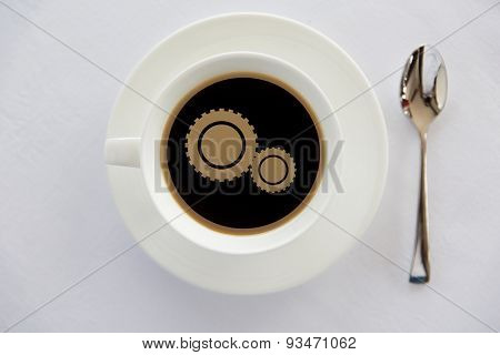 drinks, energetic, efficiency and caffeine concept - cup of black coffee with cogwheel symbol on surface and spoon