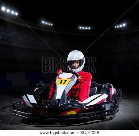 Young girl karting racer at stadium
