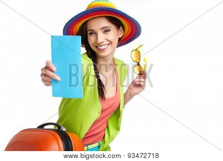 Woman tourist with travel suitcase and blue boarding pass, isolated on white  background