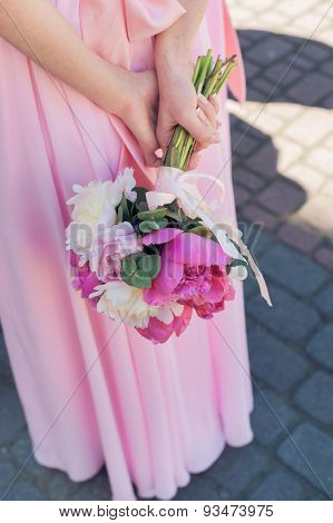bouquet in the hands of the bridesmaid. peonies flowers.