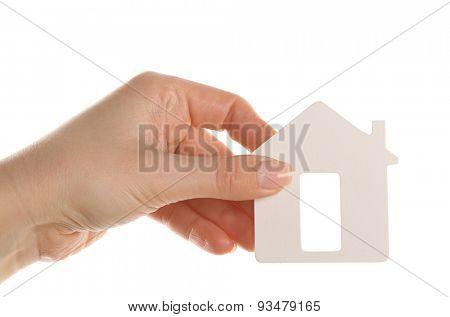 Female hand holding model of house isolated on white
