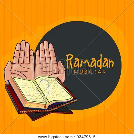 Islamic holy month of fasting and prayers, Ramadan Mubarak celebrations concept with praying human hands and Quran Shareef on yellow and grey background.