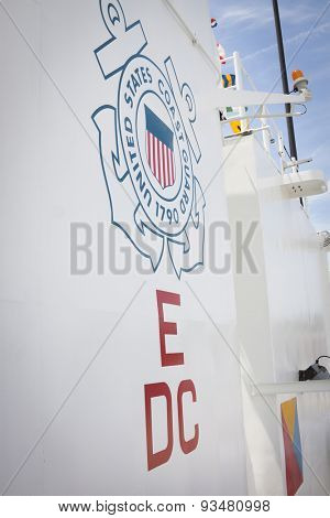 STATEN ISLAND, NY - MAY 24 2015: The Coast Guard insignia on the side of the USCGC Spencer (WMEC 905) a Medium endurance cutter and mooring bollards on Sullivans Pier during Fleet Week NY 2015.