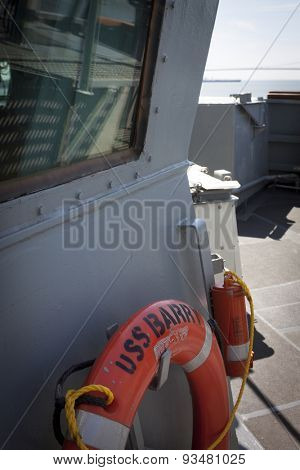 STATEN ISLAND, NY - MAY 24 2015: An orange lifering on the deck of the USS Barry (DDG 52) moored at Sullivans Pier in Staten island during Fleet Week NY 2015.
