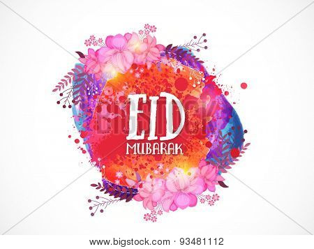 Stylish text Eid Mubarak on colorful splash and flowers for muslim community festival, Eid Mubarak celebration.