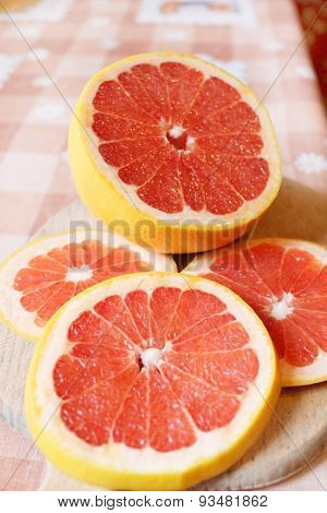 Fresh Sliced Grapefruit On The Table