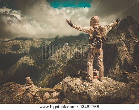 Hiker on a top of a mountain
