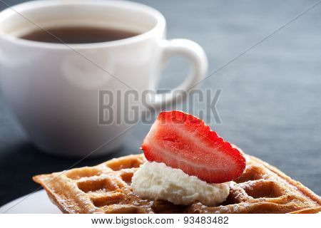 waffles with strawberry and whipped cream