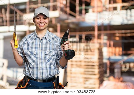 Handyman with a tool belt in a construction site