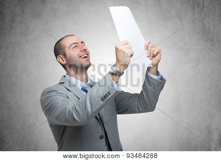 Portrait of a very happy man holding a document