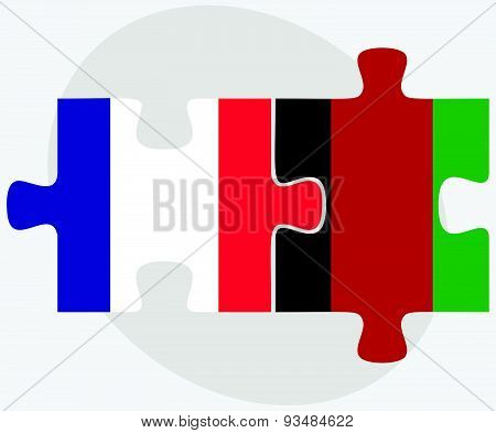 France And Afghanistan Flags In Puzzle