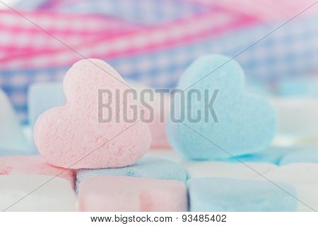 Pink and blue candy hearts for baby card