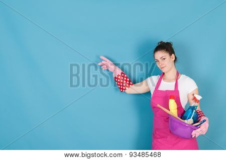Young woman with full equipment to clean the interior
