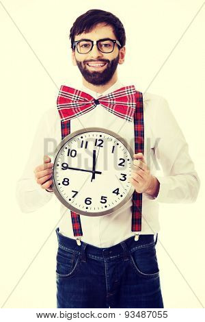 Funny man wearing suspenders holding big clock.
