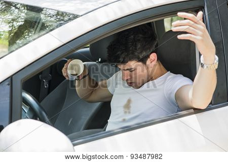Frustrated Man in Car with Spilled Coffee on Shirt