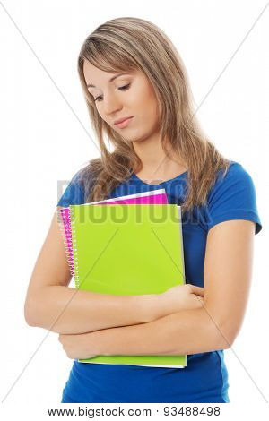 Depressed blonde woman holding notes.