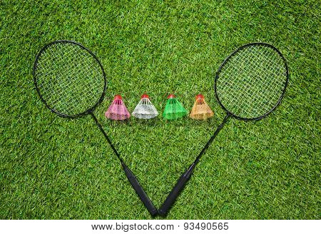 Badminton rackets with color shuttlecocks
