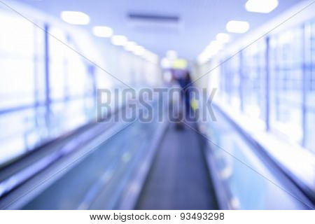 Travelator in airport out of focus - abstractl background. Toned in blue