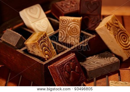 Hand made artistic soap bars in a wooden box.