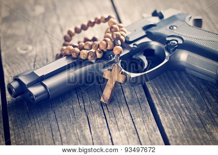 the rosary beads and gun
