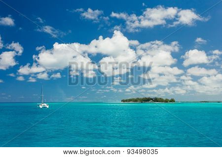 Image Of Blue Sea And A Sail Boat