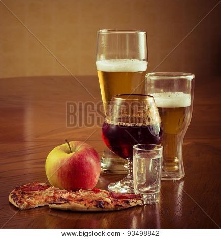 Alcoholic drinks on the table and wooden appetizer , pizza, Apple, wine, beer