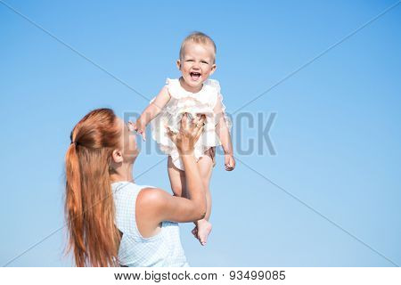 Mather and baby over blue sky