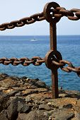 stock photo of stelles  - rusty chain water boat yacht coastline and summer in lanzarote spain - JPG