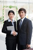 foto of korean  - Portrait of young Korean business couple outdoors - JPG