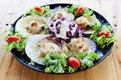 stock photo of scallops  - Baked Scallops with Cheese in black dish on wood table - JPG