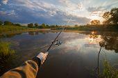 stock photo of rod  - Fisherman holding his fish - JPG