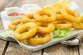 pic of deep  - deep fried calamari with lemon and salad on white tray - JPG